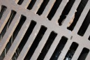 BLACK HOLE IRON GRATE COVER